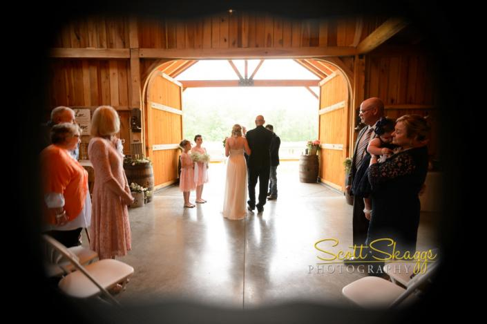 [Image: Ceremony inside the barn because of rain.]