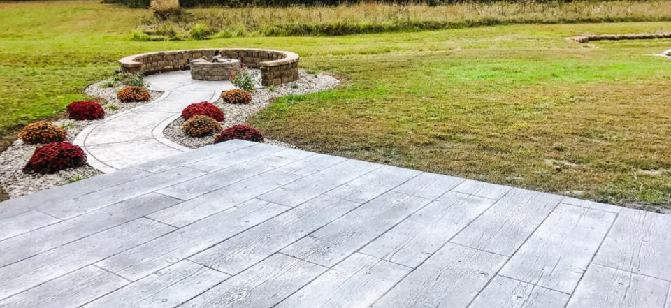 Walking to the new fire pit, you may notice that the concrete is stamped to resemble old wooden boards to be more atmospheric.